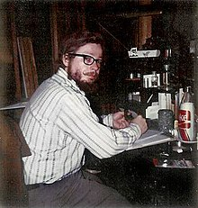 David McDaniel at his desk, writing, 1974.