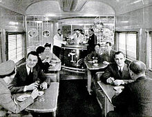 Passengers sitting at tables having a drink