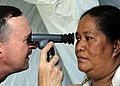 Defense.gov News Photo 110416-F-HS649-157 - U.S. Navy optometrist Lt. Cmdr. Randy Birt left uses an ophthalmoscope to check the retina of a Tongan woman at a medical site in Tuanekivale.jpg