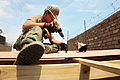 Defense.gov News Photo 120127-A-IP644-038 - U.S. Navy Petty Officer 2nd Class Michael McAfee drills to attach a roof to a new school during Southern Partnership Station 2012 in Callao Peru.jpg