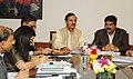Dharmendra Pradhan meeting the Minister of State for Culture (Independent Charge), Tourism (Independent Charge) and Civil Aviation, Dr. Mahesh Sharma, in New Delhi on March 13, 2015.jpg