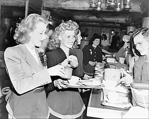Marlene Dietrich - Dietrich and Rita Hayworth serve food to soldiers at the Hollywood Canteen (17 November 1942)