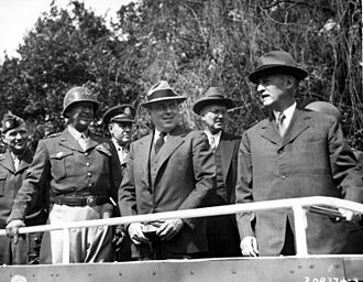 Smyth Report - Secretary of War Henry L. Stimson (right) and his advisors review the 2nd Armored Division in Germany in July 1945. Left to right: Major General Floyd L. Parks, General George S. Patton, Jr., Colonel William H. Kyle, John J. McCloy, Harvey H. Bundy