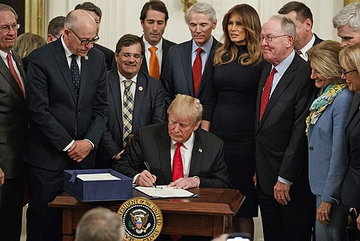 Donald Trump signing the SUPPORT Act. Public Domain.