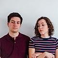 Duo Hybla posing against a white wall 01.jpg