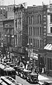 East side of Broadway, 1924.New King Hotel in Gordon Bldg. (206–10). 1920–1964 location of Victor Clothing in Crocker Bldg. (212–6) Pig 'n Whistle in Copp Bldg. (218–224), Annex to 1888 City Hall.jpg