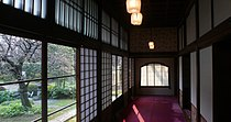 A wide photograph of a hallway from the Takahashi Korekiyo residence in the Edo-Tokyo Open Air Architectural Museum, which was one of Miyazaki's inspirations in creating the spirit world's buildings.
