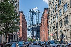 Dumbo, Brooklyn - The Manhattan Bridge, framing the Empire State Building beneath, as seen from Washington Street