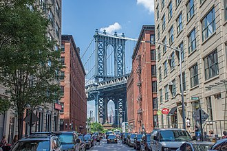 Dumbo, Brooklyn - The Manhattan Bridge, framing the Empire State Building beneath, as seen from Washington Street