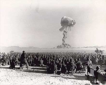 November 1951 nuclear test at the Nevada Test Site, from Operation Buster, with a yield of 21 kilotons. It was the first U.S. nuclear field exercise conducted on land; troops shown are 6 mi (9.7 km) from the blast. Exercise Desert Rock I (Buster-Jangle Dog) 002.jpg