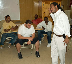 Exodus Transitional Community - Alvin Willis, an intake counsel, talks to new clients of the program.