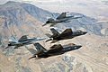 F-35Cs of VFA-101 and F-18 Super Hornets in flight near NAS Fallon in September 2015.JPG
