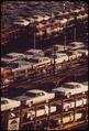FOB DETROIT-NEW CARS ARE LOADED ONTO RAILROAD CARS AT LASHER AND I-75 - NARA - 549704.tif
