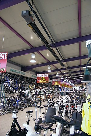 Local bike shop - Bicycles and exercise equipment for sale inside a local bike shop.