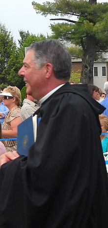 Profile of Father Jonathan walking into the Commencement exercises at Saint Anselm College