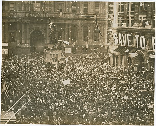 Armistice Day celebrations in Philadelphia, Pennsylvania on 11 November 1918 First News of Peace! Confetti thrown by happy crowds. Liberty sings. Flags waved. Nov. 11-1918. (12795375585).jpg