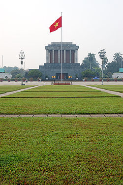 Flag of Vietnam in front of Ho Chi Minh mausoleum.jpg