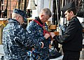 Flickr - Official U.S. Navy Imagery - A Sailor helps prepare Master Chief Petty Officer of the Navy to climb the main mast..jpg