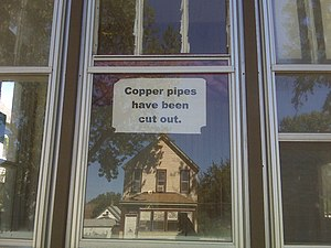 Foreclosure. Sign telling people that they hav...