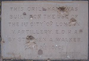 Shepherd's Bush Village Hall - Foundation stone in Shepherd's Bush Village Hall showing shrapnel damage