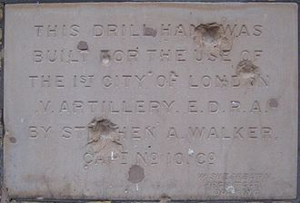 Shepherd's Bush - Foundation stone of a building in Shepherd's Bush showing Second World War shrapnel damage.