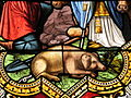 Fr Chapelle Notre-Dame-de-Lhor Saint Anthony the Great stained glass - pig detail.jpg