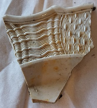 Creamware - Fragment of moulded 18th-century creamware found on Thames foreshore, central London, August 2017. Showing typical patterns of border decoration. Staffordshire, c. 1760-1780. Courtesy C Hobey.