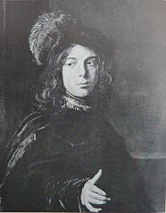 Portrait of a boy in a feathered hat