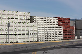 Wenatchee, Washington - Apple field bins are stacked high at a processing facility in Wenatchee.