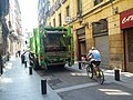 Garbage truck and bicyclist on narrow street (18823342175).jpg