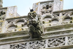 Great Ponton - Grotesque with spectacles, Holy Cross church tower