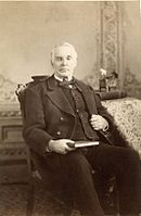 Photo of Elias Smith sitting in a chair
