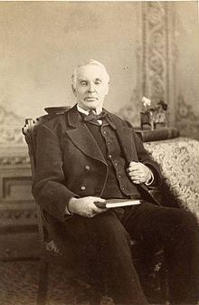 Photo of Elias Smith sitting in chair.