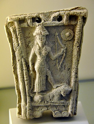 Utu - Goddess Ishtar stands on a lion and holds a bow, god Shamash symbol at the upper right corner, from Southern Mesopotamia, Iraq