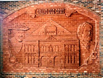Grand Ole Opry - Decorative brickwork at Opryland Hotel depicting Ryman Auditorium with Minnie Pearl and Roy Acuff