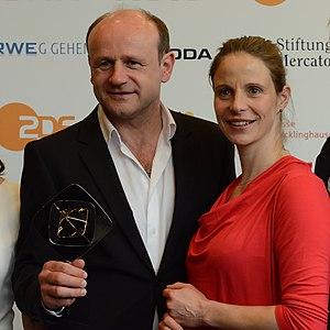 Oliver Stokowski - Oliver Stokowski and Julia Jäger at the Grimme Awards 2014