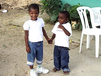 Holding hands - Two Dominican children holding hands