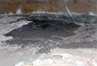 Image of the surface of waste found inside double-shell tank 101-SY at the Hanford Site, April 1989 Hanford site tank interior.jpg