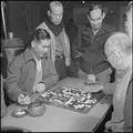 Heart Mountain Relocation Center, Heart Mountain, Wyoming. A group of centerites gather around two . . . - NARA - 539158.tif