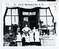 Hershman family in front of their grocery store, Minneapolis (4419498638).jpg
