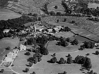 Colston's School - Black and white photograph from c.1930s showing the Church of Holy Trinity, Stapleton and the school site.The image shows an aerial view of the church from the north west, with the buildings of the surrounding settlement of Stapleton including fields, trees and allotments.