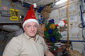 ISS-26 Scott Kelly with Santa Claus hat.jpg