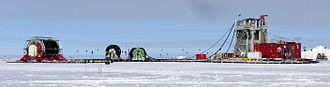 IceCube Neutrino Observatory - IceCube drilling tower and hose reel in December 2009