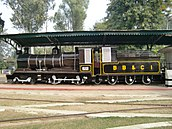 Black locomotive under cover