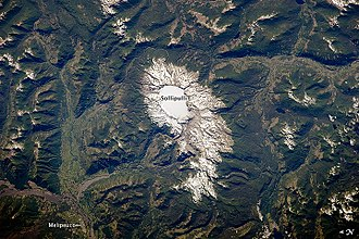 Caldera - Sollipulli Caldera, located in central Chile near the border with Argentina, filled with ice. The volcano is in the southern Andes Mountains within Chile's Parque Nacional Villarica.