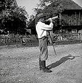 """J. Jurgalič trobi danes na voj. trampeto na vasi Groblje """"na Goric"""" (kliče krave za na gmajnarsko pašo) 1952.jpg"""