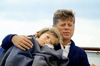 Caroline Kennedy - Caroline with her father aboard the yacht Honey Fitz off the coast of Hyannis, Massachusetts at age five, August 25, 1963.