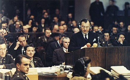Chief American prosecutor Robert H. Jackson addresses the Nuremberg court. 20 November 1945. Jackson Nuremberg color.jpg