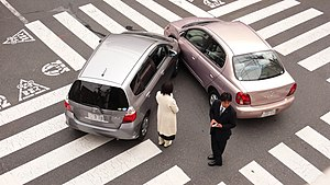 Side collision - Two cars are involved in a side collision at an intersection in Tokyo, Japan
