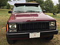Jeep Comanche 4.0L High Output six 4x4 long-bed burgundy with white cargo cap 2of3.jpg